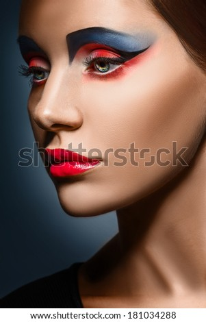 closeup beauty creative red and blue makeup woman face - stock photo
