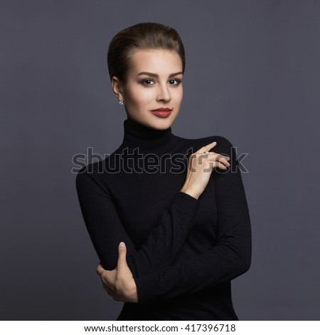 Closeup beauty portrait of a young brunette model in a black roll neck jumper. Sensual girl with short hair - stock photo