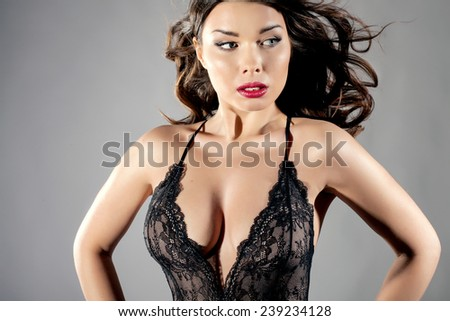 Closeup beauty portrait of attractive brunette woman. Girl in sensual lingerie. - stock photo