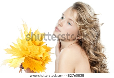 closeup beauty portrait of attractive caucasian woman blond isolated on white studio shot lips skin face hair head and shoulders blue eyes hand holding yellow marple autumn leaves