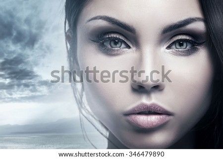 Closeup beauty portrait of attractive young woman with beautiful brown eyes. Brunette girl. Studio shot. - stock photo