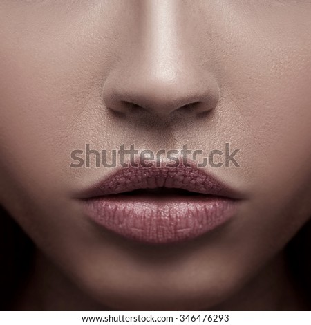 Closeup beauty portrait of attractive young woman with beautiful brown eyes. Studio shot.