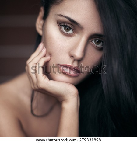 Closeup beauty portrait of sensual brunette girl with long black hair.