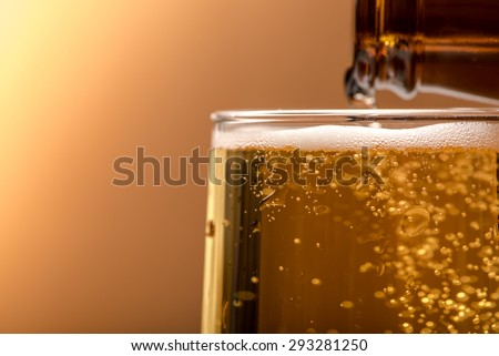 closeup beer in glass on wood table - stock photo