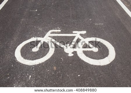 Closeup bicycle lane sign on road