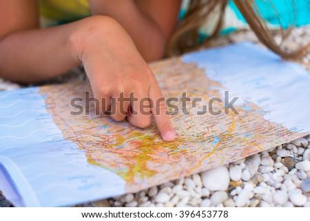 Closeup big map on tropical beach vacation - stock photo