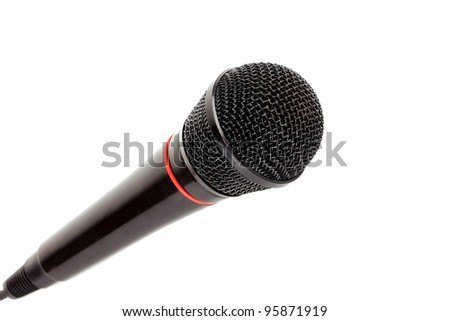 Closeup black microphone on white background