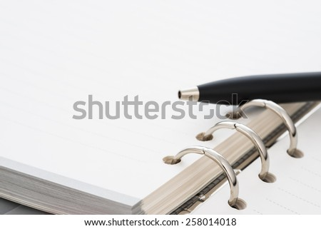 closeup black pen on business a book - stock photo