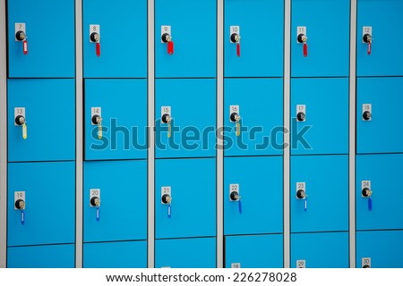 closeup blue deposite boxes with keys. left luggage checkroom background - stock photo