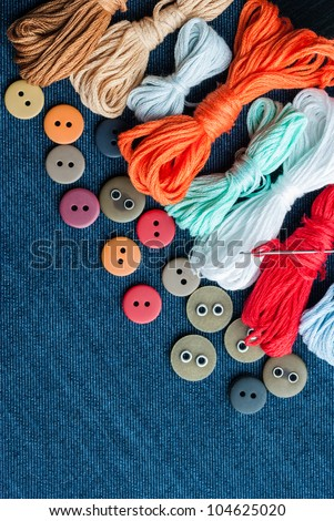 Closeup blue jeans background with different buttons and threed. Space for your text. - stock photo