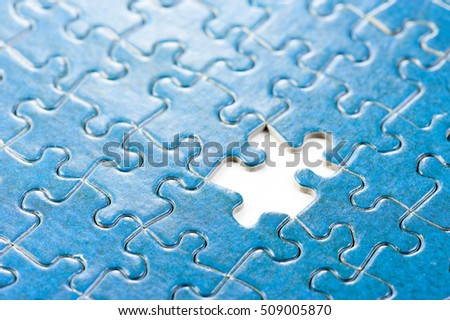 closeup blue jigsaw puzzle game, the last piece