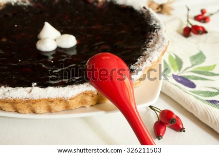 closeup blueberry pie in a plate with decorative dog rose