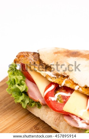Closeup bread sandwich with lettuce meat tomato