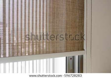 Closeup Brown Color Roller Blinds Curtains Sunlight Through The Windows And Roller Blind In The
