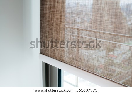 Closeup Brown Color Roller Blinds Curtains. Sunlight Through The Windows In  The City