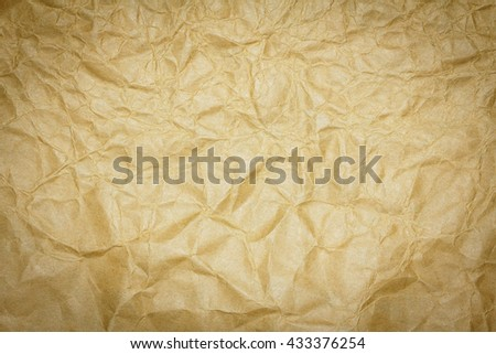 Closeup brown recycled crumpled paper texture or brown recycled crumpled paper background. Brown paper sheet for design with copy space for text or image. Dark edged. - stock photo