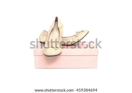 Closeup brown woman shoes on pink paper box of shoes isolated on white background with clipping path - stock photo