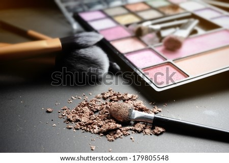 closeup brushes with colorful cosmetics - stock photo