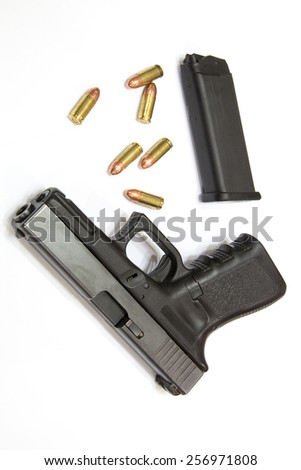 Closeup Bullets and Gun on white background - stock photo