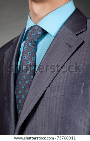 closeup businessman suit over gray background