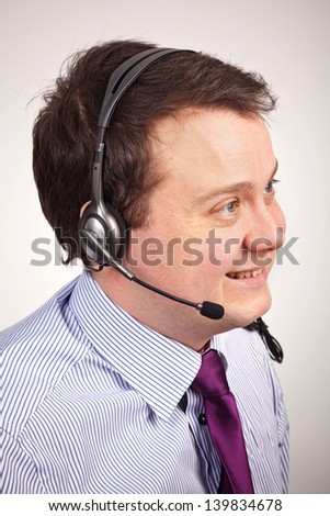 Closeup businessman talking with a headset - stock photo