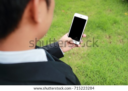 closeup businessman using smartphone and touch screen