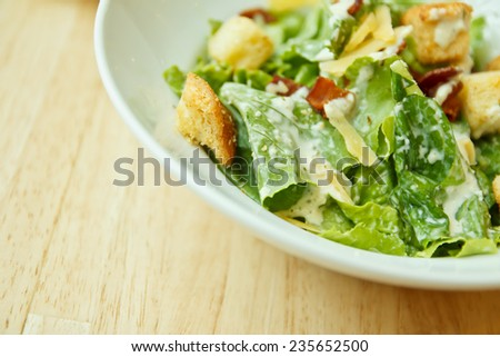Closeup caesar salad on wood table