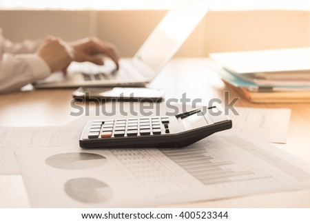 Closeup calculator on business and financial report with business people are analyzing growth business. Accounting concept. - stock photo