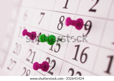 Closeup calendar page with drawing-pin - stock photo