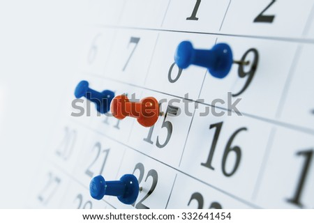 Closeup calendar page with drawing-pin - stock photo