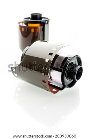 closeup camera film isolated on white background - stock photo
