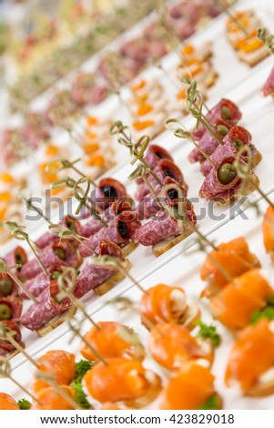 closeup canapes and snacks for catering service with selective focus - stock photo