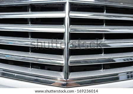 closeup car grill with sunlight shinning