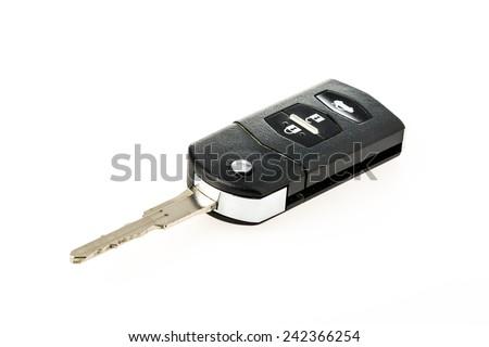 closeup car key on white background - stock photo