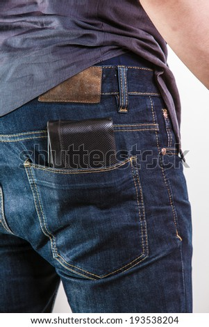 Closeup. Careless man with wallet on his back pocket. Risk of theft. Isolated on white. Studio shot. - stock photo