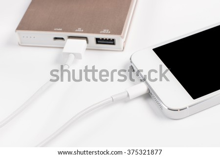 Closeup Charging Smartphone on white background
