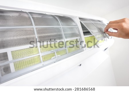 closeup clean air conditioner filter of wall type air conditioner - stock photo
