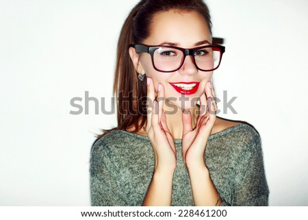 Closeup colorful fashion hipster portrait of young happy smiling girl with glasses and red lips  - stock photo