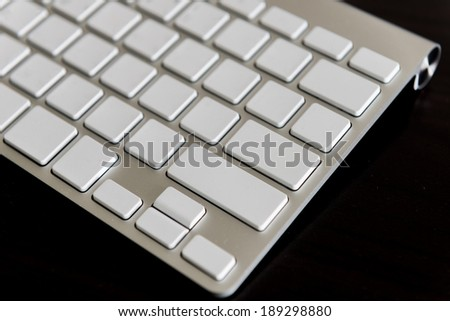 closeup Computer keyboard. on wooden background