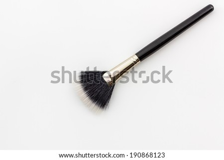 Closeup Cosmetic brush on the white background.