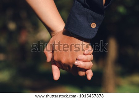 closeup couple holding hand together,love concept