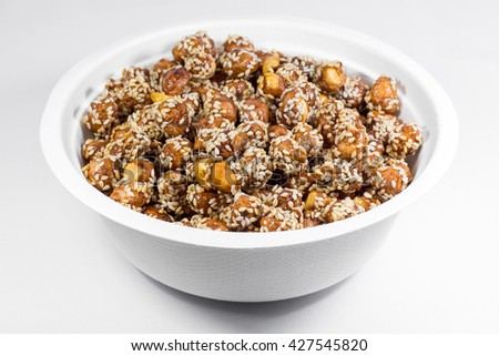 Closeup Crispy Sugared Nuts in a White Bowl (Isolated photo) - stock photo