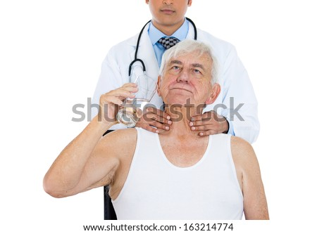 Closeup cropped image of doctor performing physical exam, palpation of thyroid gland. Young male doctor and old elderly sick patient, isolated on a white background. Patient visit and care concept - stock photo