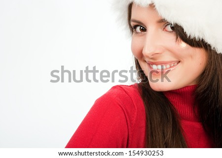 Closeup cropped portrait of a beautiful friendly woman in a Santa hat smiling at the camera isolated on white with copy space