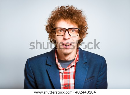 closeup curly amazed man isolated on a background - stock photo
