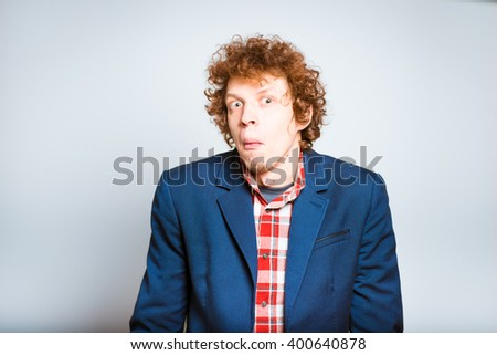 closeup curly confused man isolated on a background - stock photo