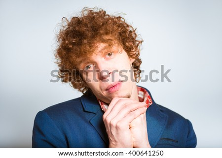 closeup curly man guilty apologizes, isolated on background - stock photo
