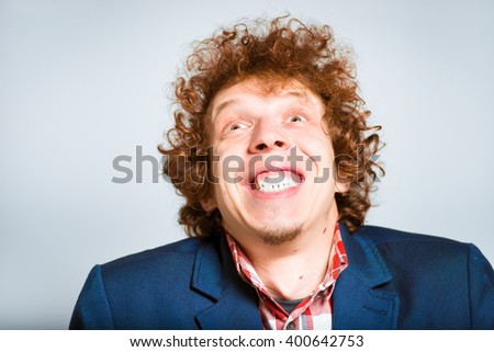 closeup curly man in delight, isolated on background