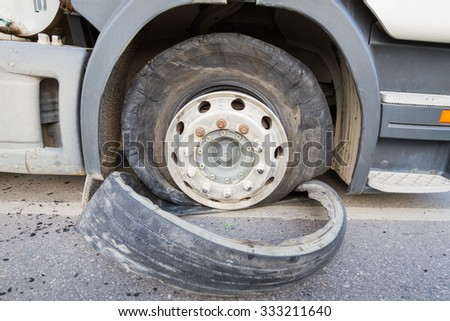 closeup damaged 18 wheeler semi truck burst tires by highway street. - stock photo