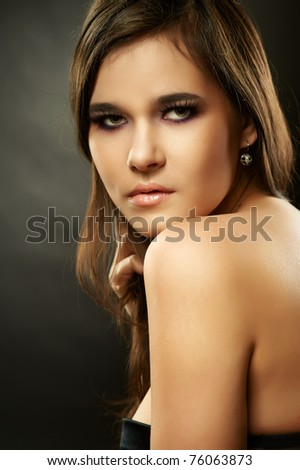 Closeup dark portrait of young beautiful woman